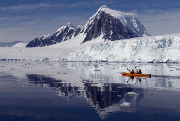 Kayak through the icy landscape of Glacier Bay, Alaska